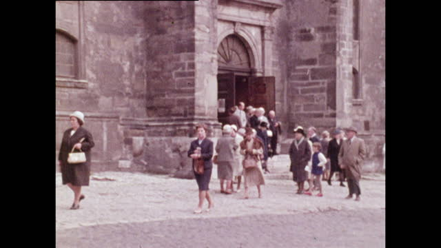 people leave church in the centre of weimar, east germany; 1970 - weimar stock videos & royalty-free footage