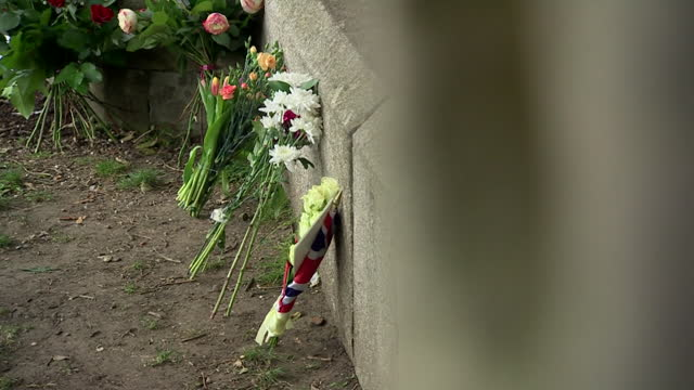 people leave floral tributes at windsor castle following the death of prince philip, duke of edinburgh - monument stock videos & royalty-free footage