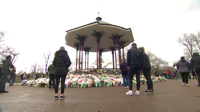 people leave flowers at bandstand on clapham common, in memory of sarah everard, who was kidnapped and murdered on her walk home, sparking... - sparks stock videos & royalty-free footage