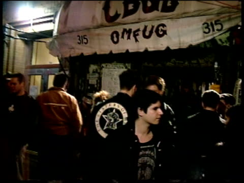 people leaving cbgb's and exterior awning - leather jacket stock videos and b-roll footage
