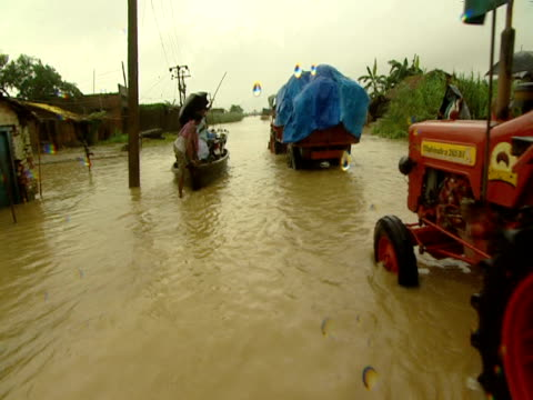 people leaving flooded area using various forms of transport india - variation stock videos & royalty-free footage