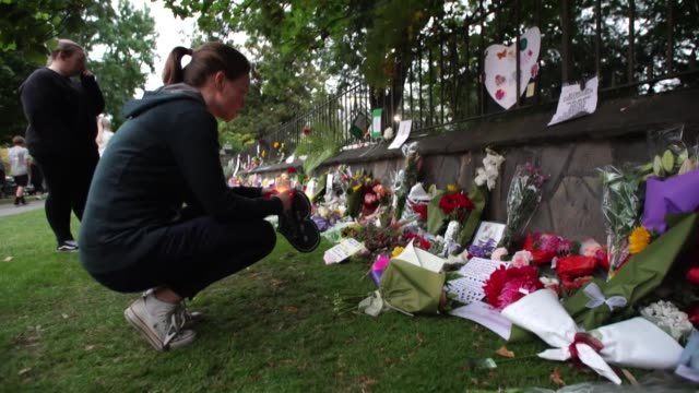 People leaving flowers and messages of condolence in Christchurch after a white supremacist terrorist attack on two mosques