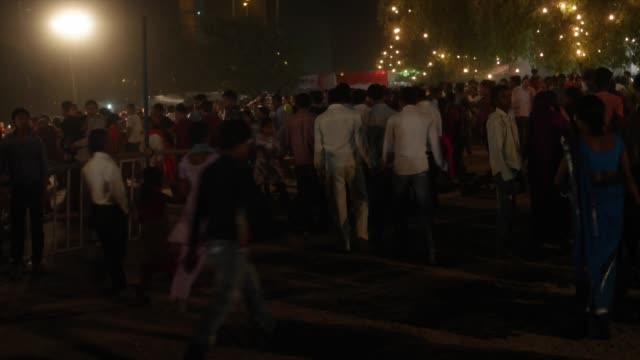 people leaving the ceremonial grounds in huge numbers / dussehra is one of the most important hindu festivals celebrated in various forms across the... - dashahara stock-videos und b-roll-filmmaterial
