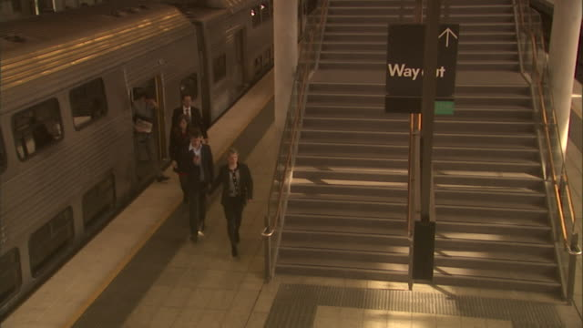 HA, TD, MS, People  leaving train and ascending steps, Olympic Park railway station, Sydney, Australia