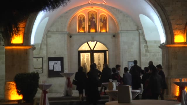 people light candles during a christmas church service at antakya orthodox church in hatay turkey on december 24 2015 children perform a play... - hatay stock videos & royalty-free footage