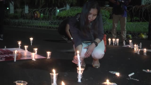 People light candles to protest against death sentence policy of government at presidential palace in Jakarta Indonesia on July 28 2016
