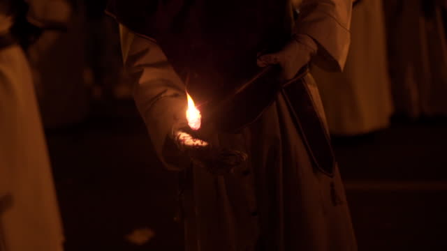 people light torch for easter, spain - happy easter stock-videos und b-roll-filmmaterial