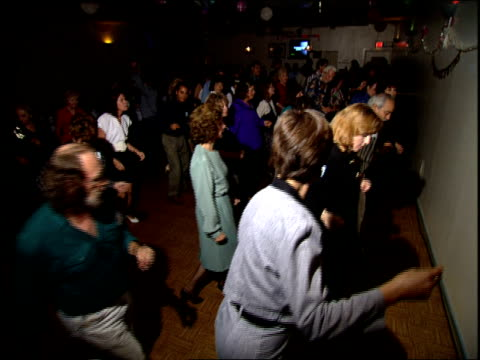 people line dancing at a valentine's day party in miami, florida - anno 1994 video stock e b–roll