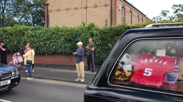 people line the streets as the funeral cortege of jack charlton passes through his hometown of ashington in northumberland ahead of his funeral... - jack charlton stock videos & royalty-free footage