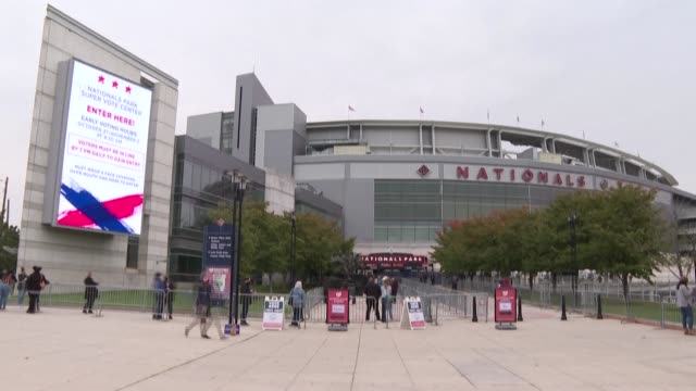 people line up to cast their ballots at nationals park, a baseball stadium converted into a polling station, as early voting starts in washington,... - nationals park stock videos & royalty-free footage