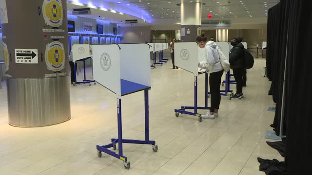 people line up to cast their vote at the madison square garden as early voting has started as of today morning for the 2020 u.s presidential... - voting stock videos & royalty-free footage