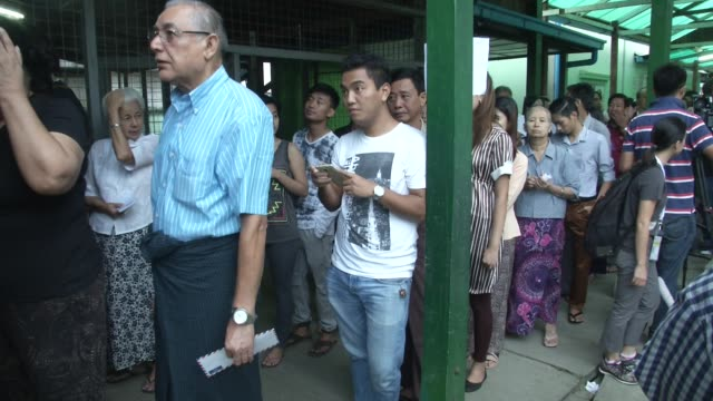 People line up to vote at a polling station in Bahan Township Yangon during Myanmar's first free and fair election The elections will be Myanmar's...