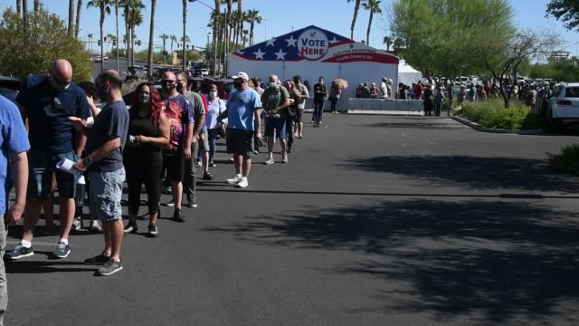 people line up to vote at a shopping center on the first day of in-person early voting on october 17, 2020 in las vegas, nevada. early voting for the... - voting stock videos & royalty-free footage