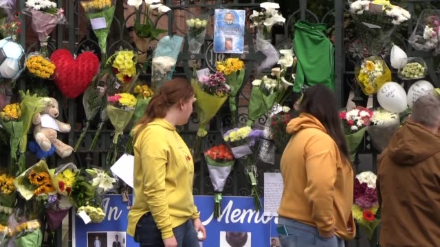 vídeos de stock, filmes e b-roll de people lined the streets of belfast to say a final farewell to teenager noah donohoe who was found dead after a major search operation. the funeral... - major road