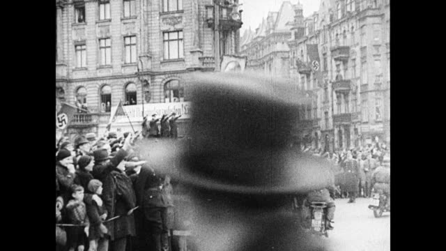 stockvideo's en b-roll-footage met ws people lining street arms up in nazi salute buildings w/ nazi banners bg nazi germany propaganda minister joseph goebbels walking at head of... - 1937