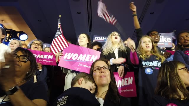 people listen as democratic presidential candidate former new york city mayor mike bloomberg speaks during a rally held at the hilton mclean tysons... - candidate stock videos & royalty-free footage