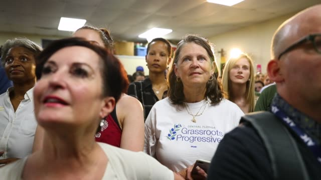 people listen as they attend a campaign rally for the democratic candidates for government offices in the state of florida at the international union... - florida us state stock videos and b-roll footage