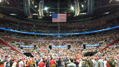 people listen as u.s. president donald trump speaks during a homecoming campaign rally at the bb&t center on november 26, 2019 in sunrise, florida.... - homecoming stock videos & royalty-free footage