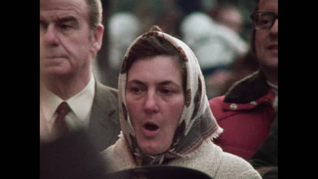 people listen to a brass band, uk, 1970s - ブラスバンド点の映像素材/bロール