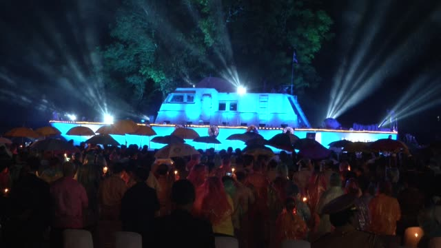 people listen to music and watch light show while it rains during the 10 years after the tsunami memorial services are held at the police boat 813... - police boat stock videos and b-roll footage
