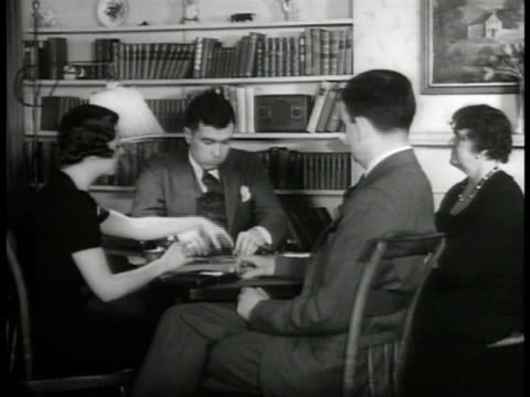 two couples playing cards at table in den men in rural clothing sitting around pot belly stove ms mail sacks being emptied of contents large bundles... - pot belly stock videos & royalty-free footage