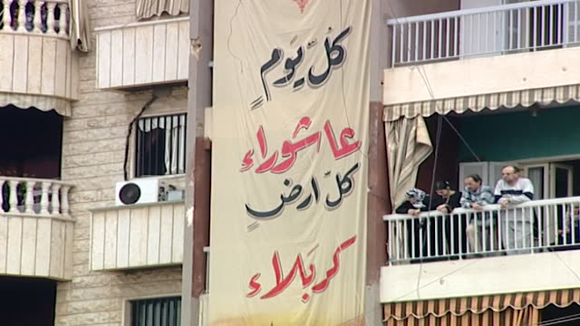 people listening to secretary general of hezbollah hassan-nasrallah giving his ashura speech. banner reads: every day is ashoura and every land is... - secretary general stock videos & royalty-free footage