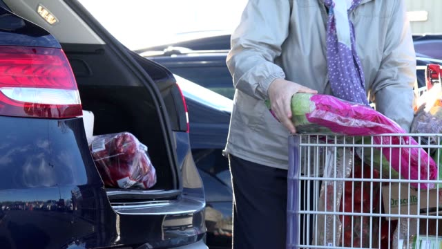 people loading her purchase in america - only mature women stock videos & royalty-free footage