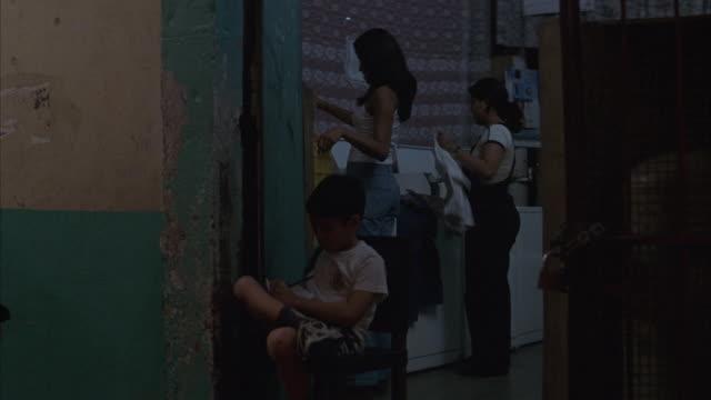vídeos de stock, filmes e b-roll de people loiter in an alley. - prostituta