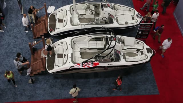 People look at boats on display at the Miami International Boat Show in the convention center in Miami Beach Florida Miami International Boat Show...
