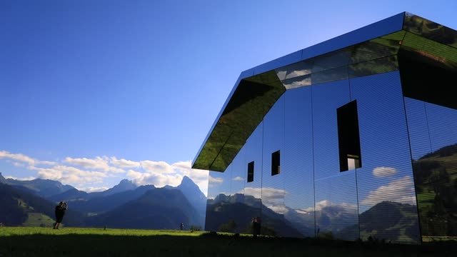 people look at mirage gstaad by los angelesbased artist doug aitken is on display outside as installation sculpture representing a chalet made with... - kaleidoscope pattern stock videos & royalty-free footage