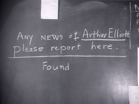 people look at missing person blackboards at the benfleet relief centre following the terrible flooding along the east coast of england. - missing people stock videos & royalty-free footage