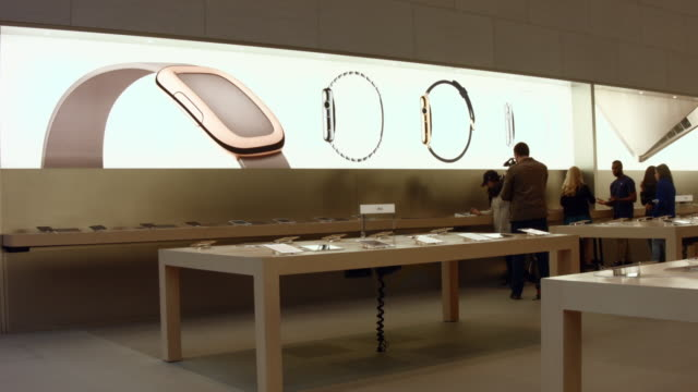 people look at the new apple watch at an apple store in manhattan on april 10, 2015 in new york, new york. consumers around the world were able to... - big tech stock videos & royalty-free footage
