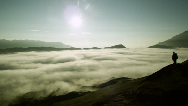 """people look over cloud filled valley, java. - """"bbc natural history"""" stock videos & royalty-free footage"""