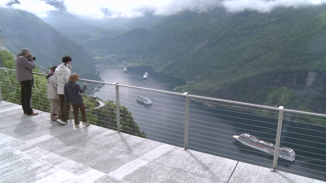 ws people looking at cruise-ships in geirangerfjord / geiranger, more og romsdal, norway - tourist stock videos & royalty-free footage
