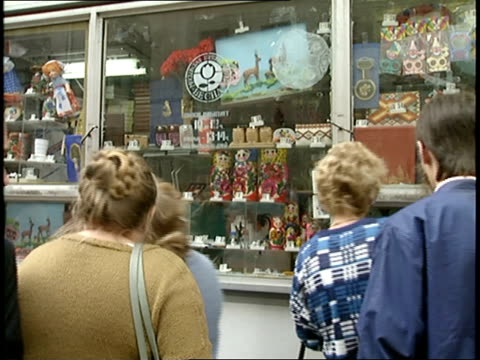 People Looking at Matryoshka Dolls in Moscow Store Window