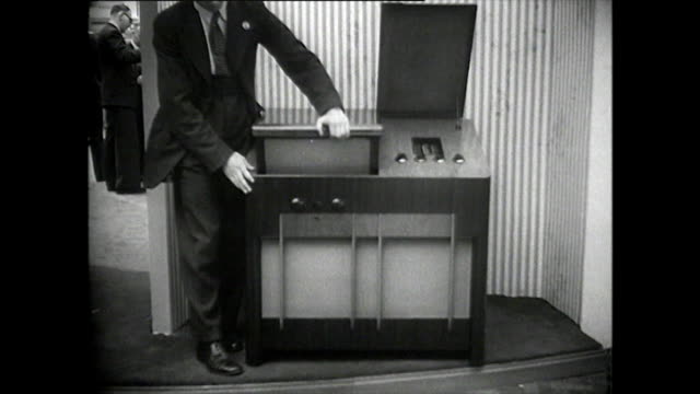 b&w - people looking at new televisions at exhibition; 1952 - exhibition stock videos & royalty-free footage