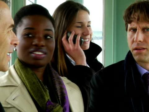 cu, people looking at woman talking on mobile phone on train station, chappaqua, new york state, usa - 全套西裝 個影片檔及 b 捲影像
