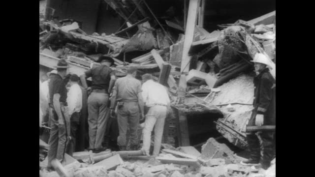 People looking through explosion debris for missing persons / medical personnel arriving / workers sifting through rubble / survivor on stretcher...
