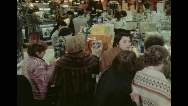 people looking through sales items in debenhams department store, at the start of the boxing day sales, 1978 - archival stock videos & royalty-free footage