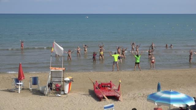 people make water aerobics at manaccora beach at the adriatic sea - adriatic sea stock videos & royalty-free footage