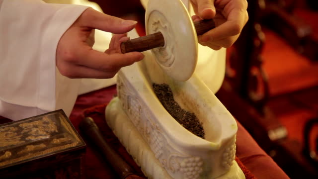 people making tea by chinese traditional methods - dried tea leaves stock videos & royalty-free footage