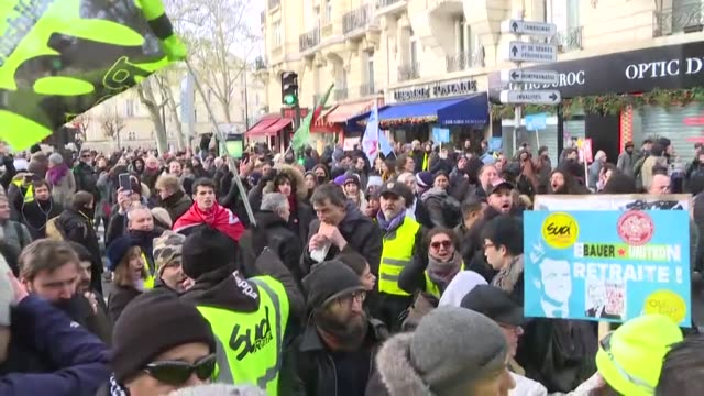 people march during a protest against pension reforms by government of president emmanuel macron as part of the sixth day of massive strike in paris,... - ストライキ点の映像素材/bロール