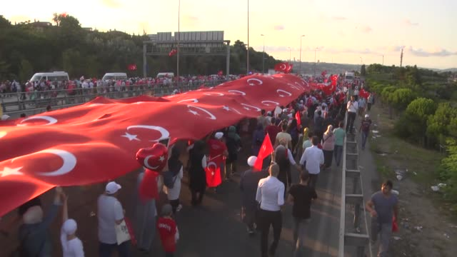 People march to 15 July Martyrs Bridge during the national unity march as part of the July 15 Democracy and National Unity Day in Istanbul Turkey on...