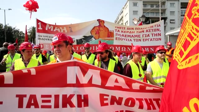people march to sintagma square during international workers' day celebrations in athens greece on may 1 2017 - may day international workers day stock videos & royalty-free footage