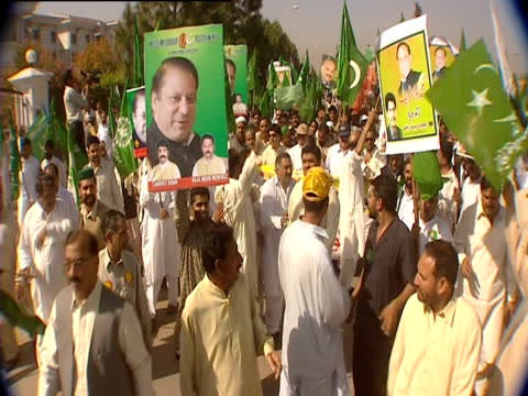 people marching in support of the supreme court - pakistani flag stock videos & royalty-free footage