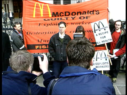McDonalds Libel Damages Reduced ITN ENGLAND London High Court GVs Dave Morris and Helen Steel posing for photo opportunity outside court