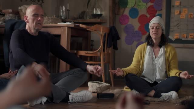 People meditating /practicing yoga together