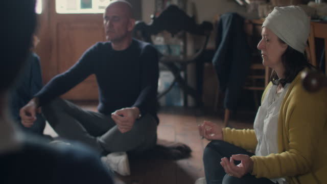people meditating together - counselling session stock videos & royalty-free footage