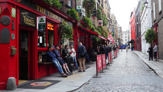 people meeting at dublin temple bar pub - pub stock videos & royalty-free footage