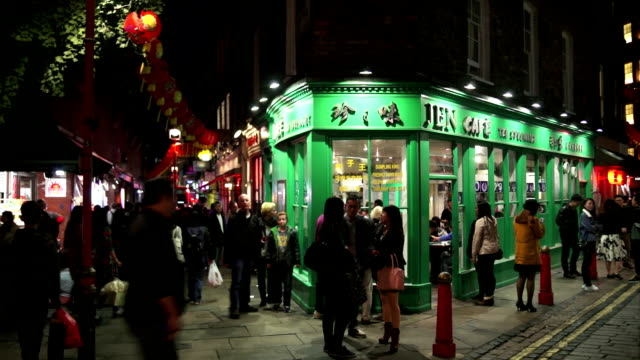 people meeting in london chinatown newport place night shot - chinatown stock videos & royalty-free footage